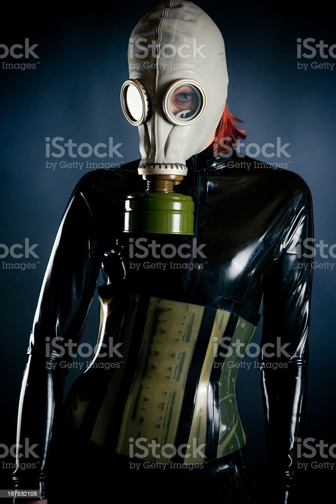 Woman in latex and gasmask