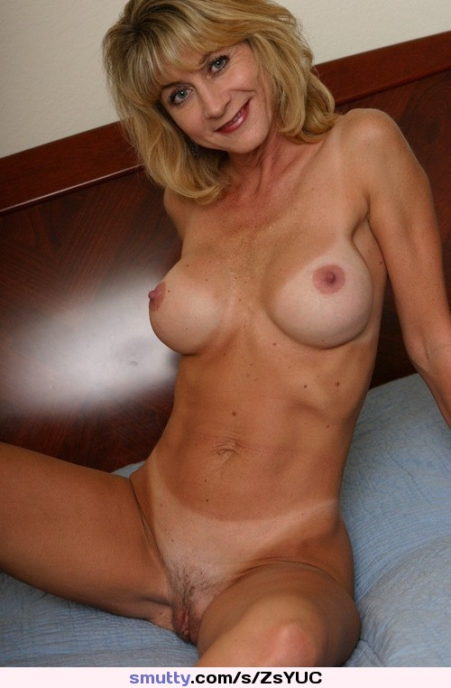 Smiling nude wife